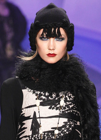 Red lips at the Anna Sui f/w '14 show (photo by: Marcus Tondo for style.com)